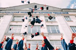 graduates throwing caps - vasily-koloda-620886-unsplash