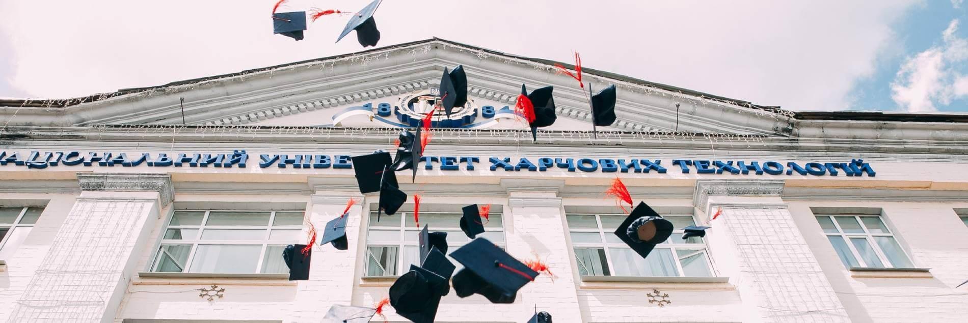 graduates throwing caps banner - vasily-koloda-620886-unsplash-1
